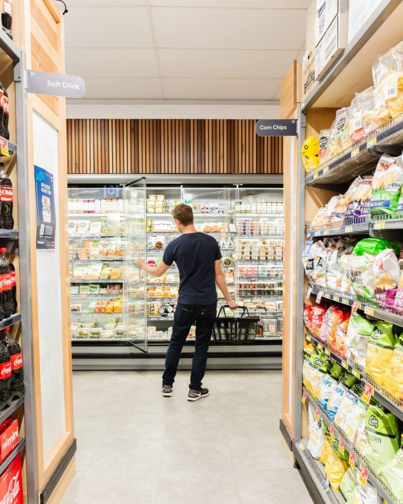 Iga Milton customer in freezer section