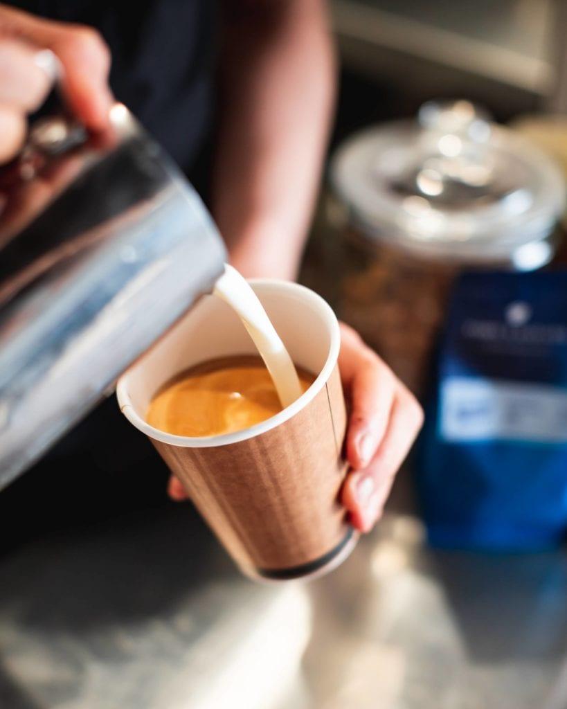 Iga Milton pouring coffee